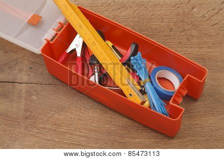 Plastic Toolbox And Tools On A Wooden Background