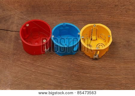 Plastic Enclosure For Installation Of Electrical Household Appliances On Wooden Background