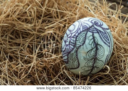 Nest With Easter Eggs On The Wooden Background