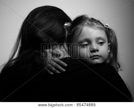 Family Lifestyle. Daughter Hugging Her Mother And Looking Serious