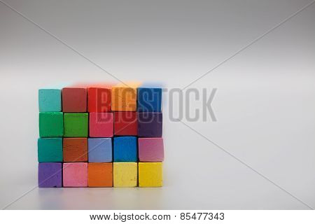 Different Pastel Colors Stacked In Front Of Gray Background