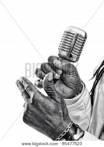Black Singer Hold A Microphone  Isolated On White