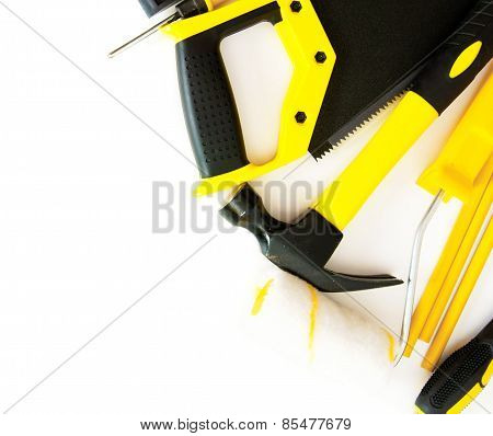 Many working tools - hammer, saw and others on white background.