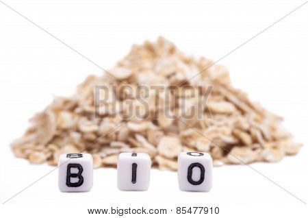 Cube Letters Show Bio In Front Of Oat Flakes