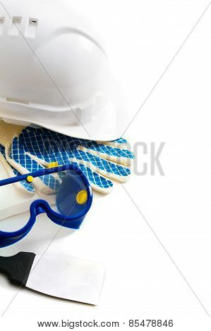 Many working tools - helmet, glove and others on white background.