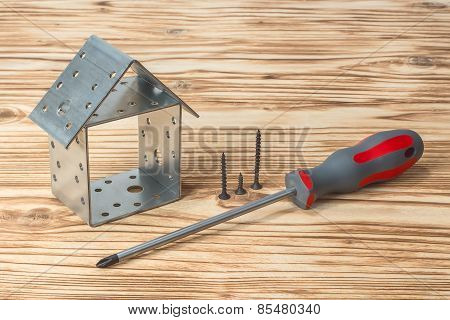 Screwdriver House On Wooden Background