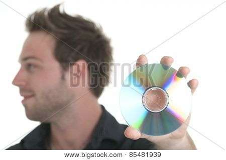 A 30 years old men holding a cd or a dvd