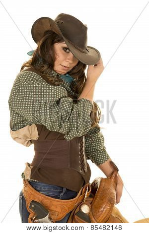 Cowgirl Holding Saddle Hand On Hat