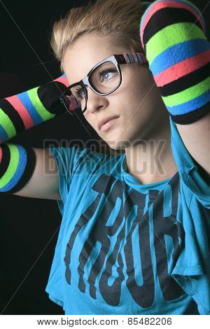 Portrait of young woman wearing striped multicolored