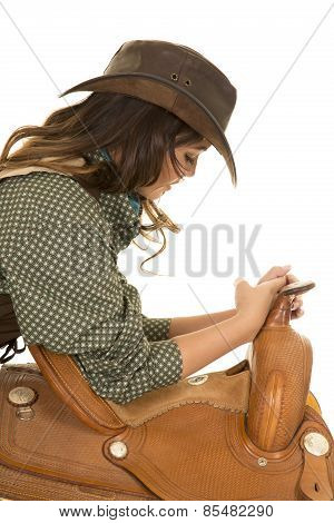 Cowgirl With Elbows On Saddle Look Down