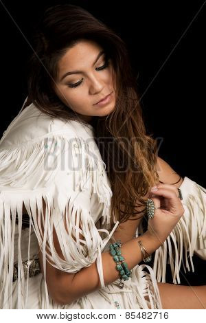 Native American Woman In White Outfit Sit On Black Close Look Down