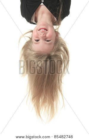A head portrait of an attractive young child in an upside-down p