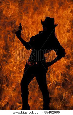 Silhouette Of Cowgirl Holding Up Gun Hand On Hip Lean Back