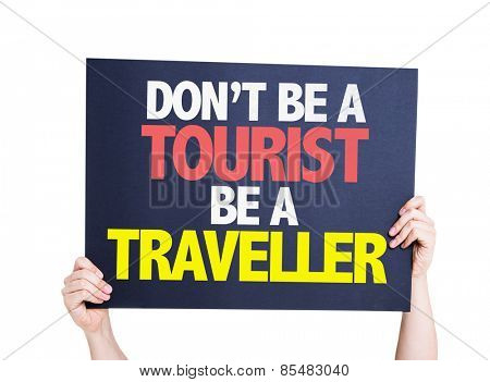 Don't be a Tourist Be a Traveller card isolated on white background