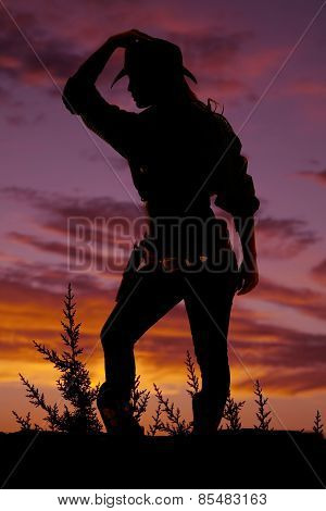 Silhouette Of Cowgirl Knee Out Lean Forward Hand On Hat