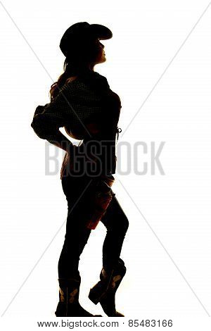 Silhouette Of Cowgirl Standing With Knee Popped Out