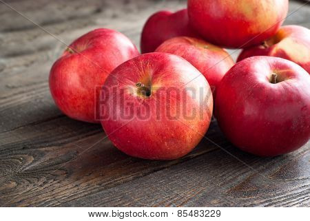 Some Red Apples At The  Table