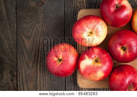 Some Red Apples On The Board