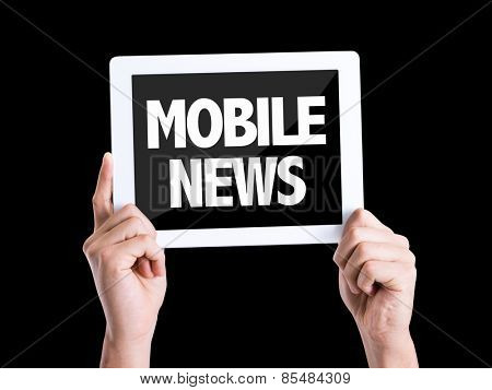 Tablet pc with text Mobile News isolated on black background