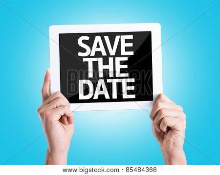 Tablet pc with text Save the Date with blue background