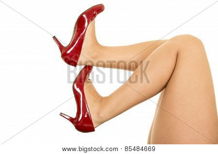 Woman Legs With Red Heels Knees Up
