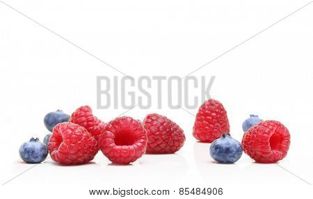 Sweet dessert waffles, raspberry and blueberry  isolated on white background.