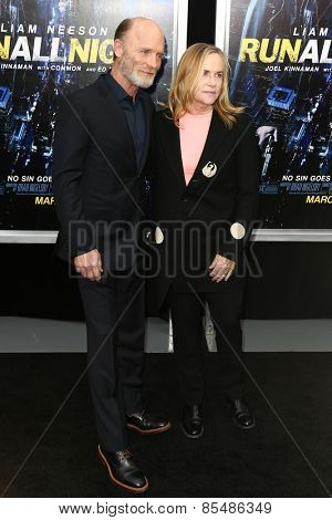 NEW YORK-MAR 9: Actors Amy Madigan (R) and Ed Harris attend the premiere of