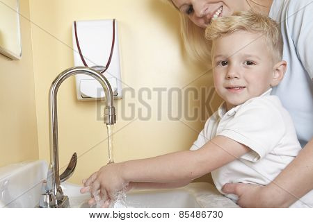 Doctor with a cute little boy wash hand