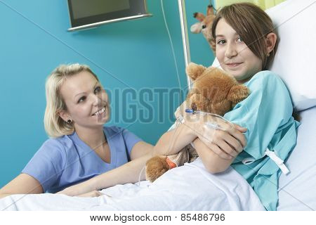 Little girl in hospital bed with the nurse
