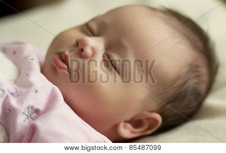 face of a sleeping baby