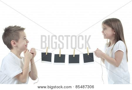 cute child holding a blank photo frame rope