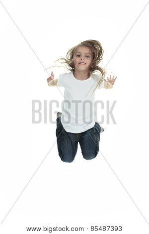 Happy little girl is jumping against white