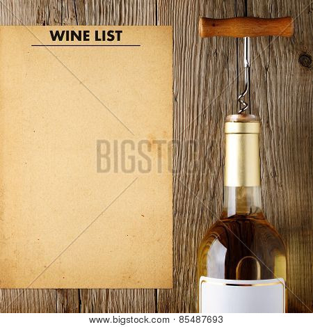 Wine Bottle And Wine List On Wooden Background