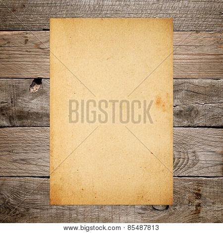 Vintage Paper On Old Wooden Background