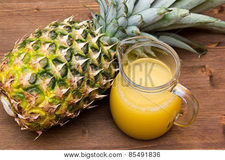 Pineapple juice on wood from above
