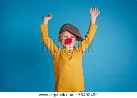 Portrait of a boy with clown nose