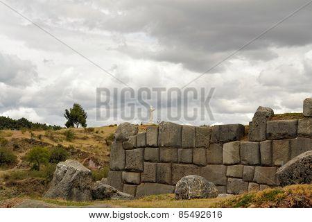 Inca fortress Saksaywaman with Jesus statue, Cusco, Peru
