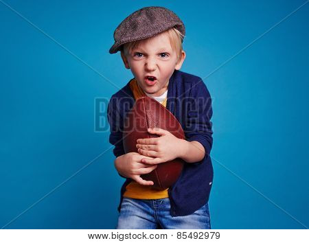Little boy with rugby ball