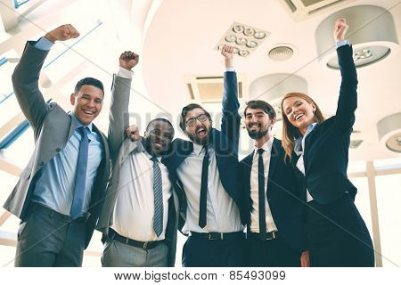 Portrait of excited business team