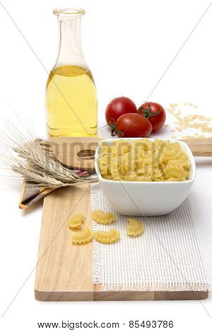 Italian Pasta, Macaroni Quills With Cherry Tomatoes And Olive Oil In A Glass Bottle