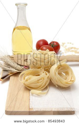 Italian Pasta, Macaroni Tagliatelle With Cherry Tomatoes And Olive Oil In A Glass Bottle