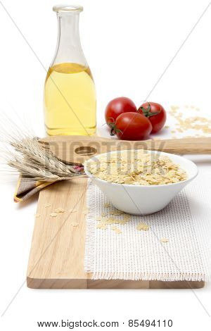 Italian Pasta, Macaroni  With Cherry Tomatoes And Olive Oil In A Glass Bottle