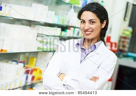 portrait of cheerful pharmacist chemist woman in pharmacy drugstore