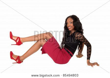 Black Woman Sitting On Floor.