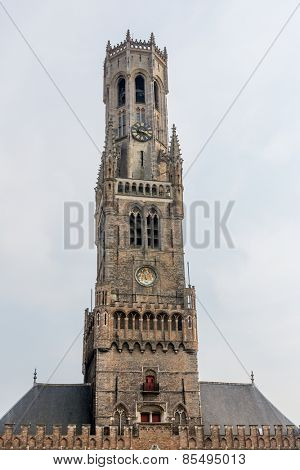 Classic view of the Belfry tower and canals of Bruges, famous city in Belgium