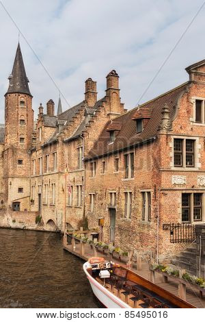 Classic view of tourist boats and canals of Bruges, famous city in Belgium