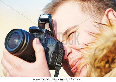 close-up of amateur photographer preparing to photograph