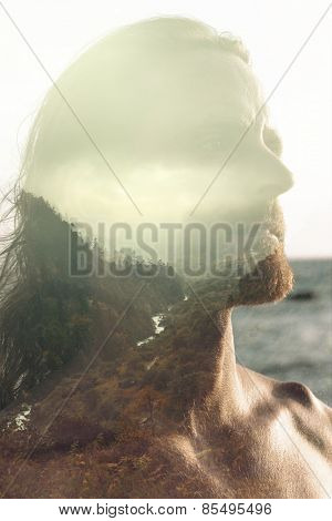 Double exposure portrait of confident man combined with landscape