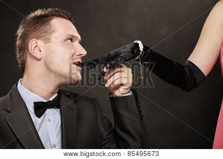 Man In Suit Biting Woman Hand Glove.