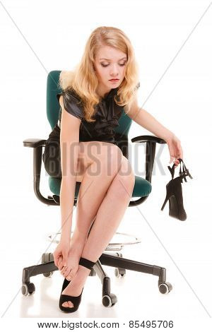 Leg Pain, Tired Woman Sitting On Chair And Massaging Feet